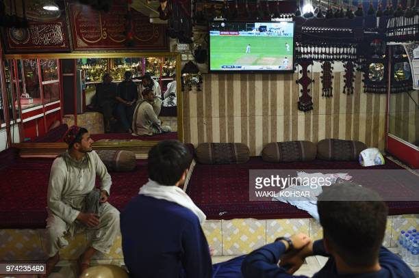 Afghan cricket fans watch India Vs AfghanistanTest cricket match live broadcast on TV at a restaurant in Kabul on June 14 2018