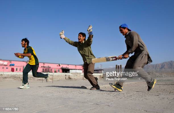 Afghan cricket players celebrate a wicket June 15 2011 in Kabul Afghanistan Cricket enthusiasm continues to grow as Out of the Ashes a documentary...