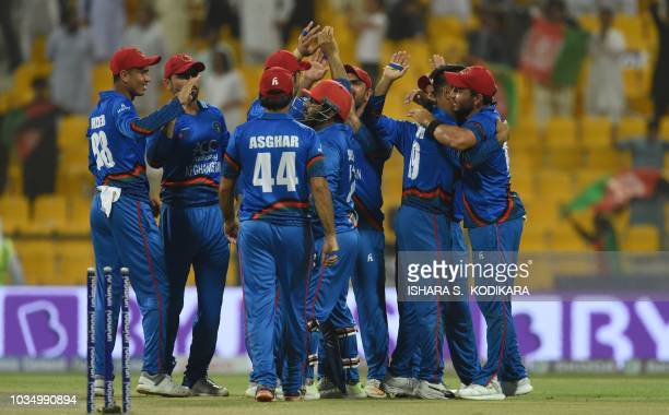 Afghan cricket team celebrates after winning during the one day international Asia Cup cricket match between Sri Lanka and Afghanistan at the Sheikh...