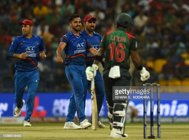 Afghan cricketer Aftab Alam celebrates after he dismissed Bangladesh batsman Liton Das during the one day international Asia Cup cricket match...