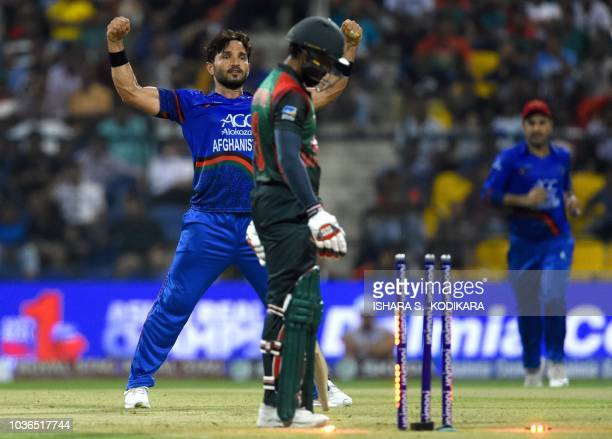 Afghan cricketer Gulbadin Naib celebrates after he dismissed Bangladesh batsman Mohammad Mithun during the one day international Asia Cup cricket...