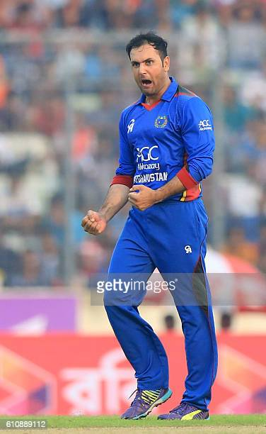 Afghan cricketer Mohammad Nabi celebrates the dismissal of Bangladesh cricketer Shakib Al Hasan during the second One Day International cricket match...