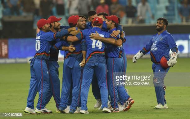 Afghan cricketer Rashid Khan captain Asghar Afghan celebrates with teammate after Match tied during the one day international Asia Cup cricket match...