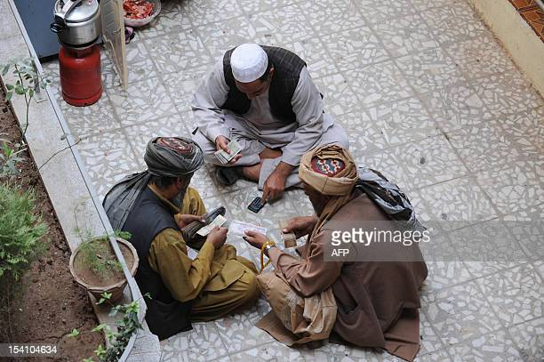Afghan dealers exchange currency at a money market in Herat on October 14 2012 With NATO combat troops due to withdraw from Afghanistan by the end of...