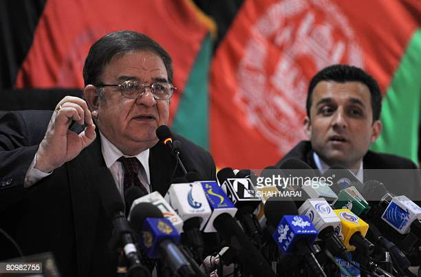 Afghan Defence Minister Abdul Rahim Wardak addresses a press conference while Afghan Intelligence chief Amrullah Saleh looks on at the Defence...