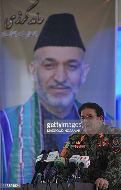 Afghan Defence Minister Abdul Rahim Wardak talks during a transition ceremony from French soldiers in Mahmud Raqi Kapisa Province on July 4 2012 The...