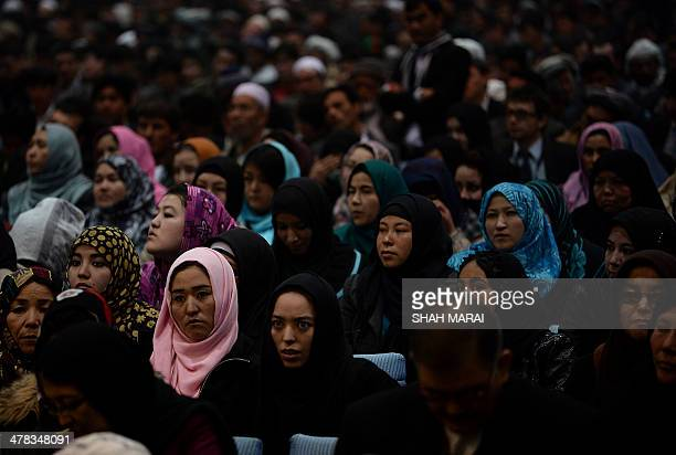 Afghan delegates listen to unseen presidential candidate Zalmay Rasool as he speaks during an election gathering in Kabul on March 13 2014...