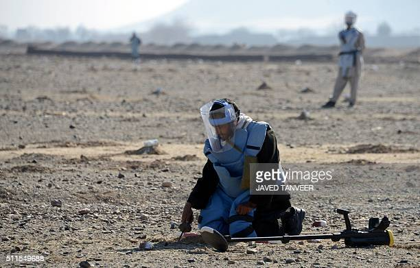 Afghan demining security personnel clear mines from a field in the Panjwai district of Kandahar province on February 21 2016 According to Mohammad...