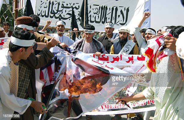 Afghan demonstrators burn an effigy of US President Obama during an antiIslam movie in Kabul on September 20 2012 The film made by extremist...