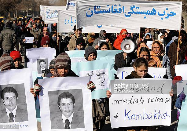 Afghan demonstrators hold pictures of journalism student Perwiz Kambakhsh in front of the United Nations Assistance Mission in Afghanistan office to...