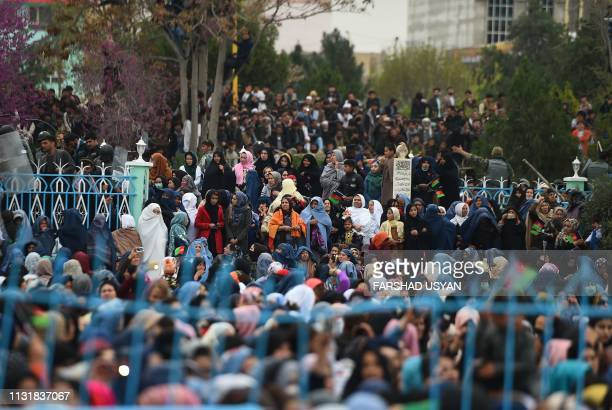 Afghan devotees gather in front of the HazrateAli shrine for Nowruz festivities which mark the Afghan new year in MazariSharif on March 21 2019...