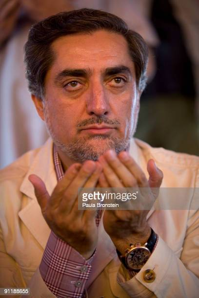Afghan doctor politician and independent candidate Abdullah Abdullah the top challenger to Presdeint Karzai in the controversial elections prays...