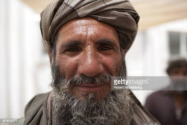 Afghan elders from Qal'ehYeNaw meet with District Governor Massoud Ahmad under a tent to voice their grievances about US Marine patrols in their...