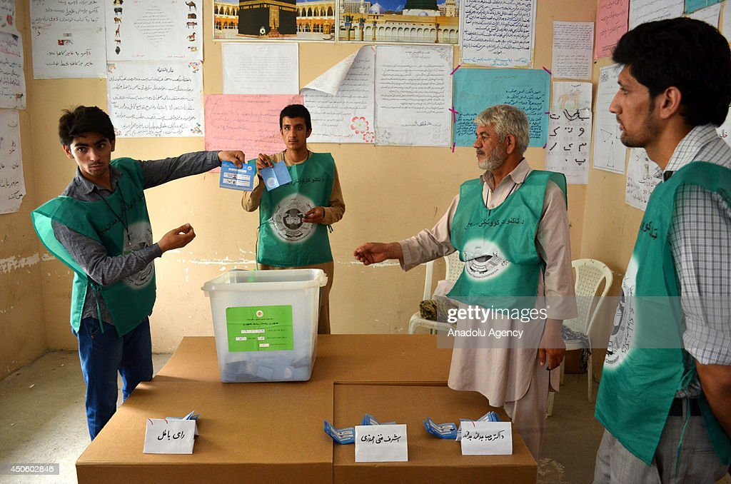 Afghan election officials count ballots at a polling station in Balkh, Afghanistan, on June 14, 2014. The voting process in the second round of Afghanistan's presidential election has ended with less voters having turned out compared to the first round.