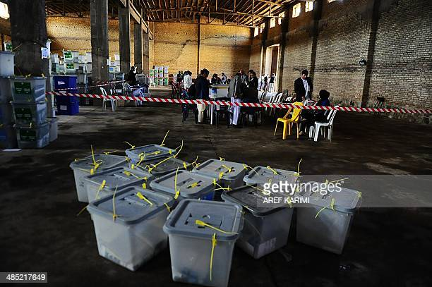 Afghan election workers count ballots at an Independent Election Commission office in Herat on April 17 2014 Leading candidates in Afghanistan's...