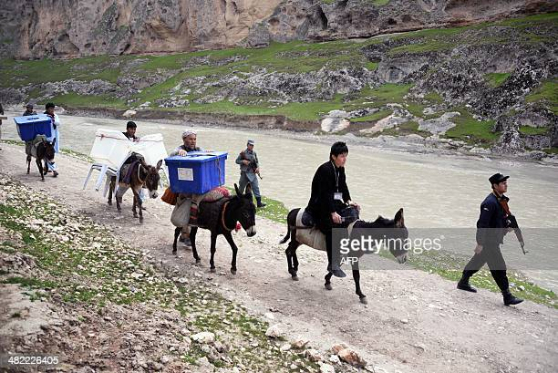 Afghan election workers use donkeys to transport election materials and ballot boxes to remote polling stations in rough districts with difficult...