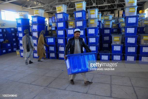 Afghan employees of the Independent Election Commission carry ballot boxes at a warehouse in Herat province on October 17 2018 Doctors Mullahs sons...