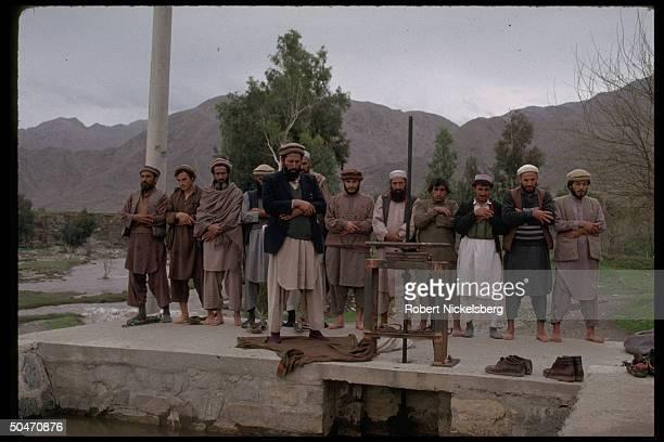 Afghan ethnic Pathan mujahedin offering prayers in rebel-controlled Kunar province capital Asadabad.
