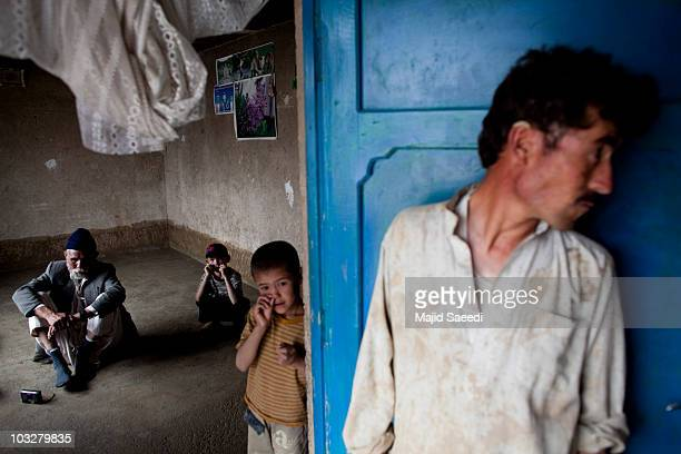 Afghan families hit by the floods which have devastated Pakistan shelter in their homes on August 7 2010 in the south of Kabul Afghanistan More than...