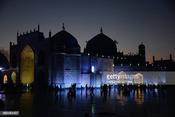 Afghan families visit and gather in the courtyard of Hazrate Ali shrine or 'Blue Mosque' in the northern city of Mazare Sharif on April 17 2014 The...
