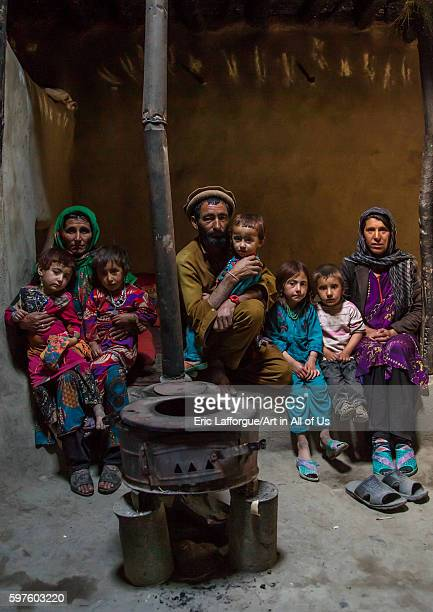 Afghan family in front of a stove badakhshan province khandood Afghanistan on August 14 2016 in Khandood Afghanistan
