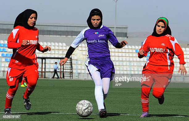Afghan female football players from Isteghlal and Afghan compete during the women's football tournament final match in Kabul on December 6 2013...