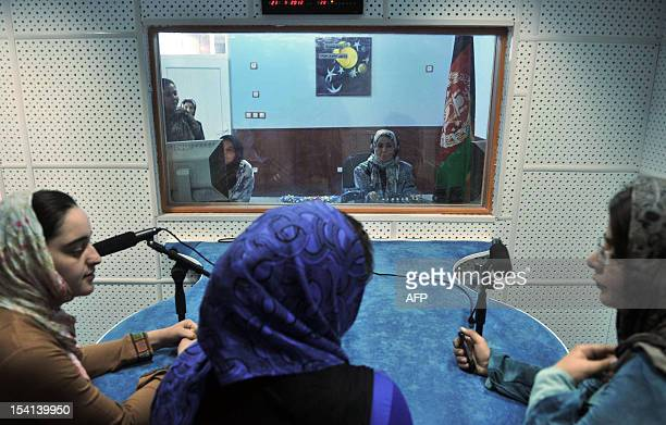 Afghan female journalists work in the studio of 'Shahrzad' the second woman's radio station to be dedicated to the interests of women in Herat on...
