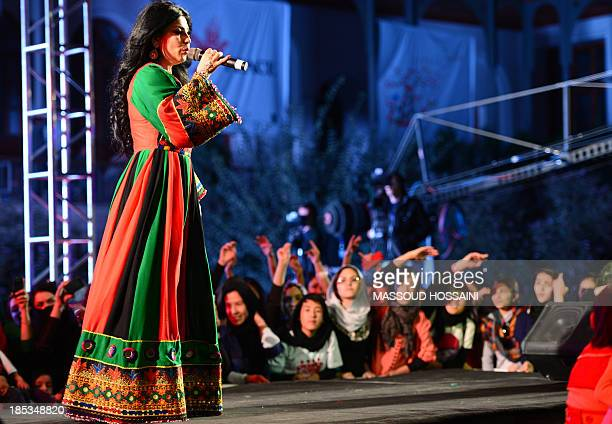 Afghan female singer Aryana Sayeed performs during a Peace Concert in Babur Garden in Kabul on October 19 2013 The Taliban who banned all kind of...