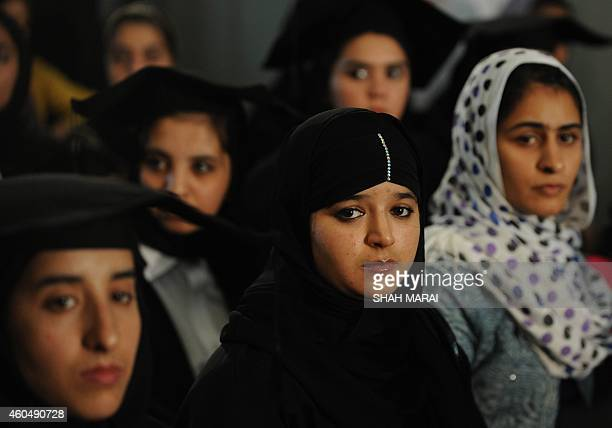 Afghan female students listen to Afghan President Hamid Karzai speak during a graduation ceremony of university students in Kabul on September 13...