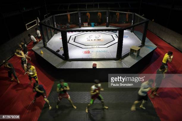 Afghan fighters are seen shadow boxing around the custom built Snow Leopard Fighting Championship ring on May 8th in KabulAfghanistan Sports like...