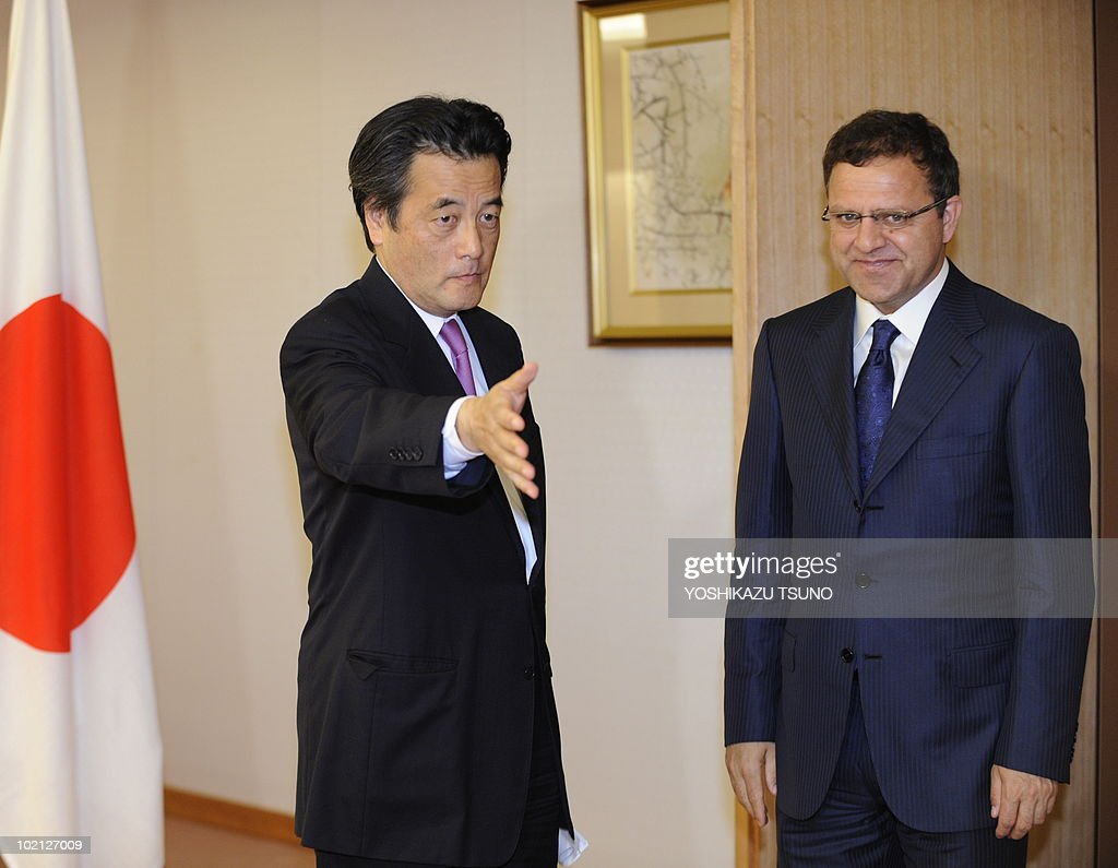 Afghan Finance Minister Omar Zakhilwal (R) is greeted by Japanese Foreign Minister Katsuya Okada for their talks at Okada's office in Tokyo on June 16, 2010. They exchanged views ahead of Afghan President Hamid Karzai's arrival. AFP PHOTO / Yoshikazu TSUNO