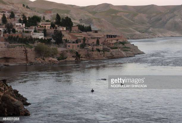 Afghan fishermen paddle rubber rafts into the Kabul River to fish on the outskirts of Jalalabad in Nangarhar Province on April 10 2014 Leading...
