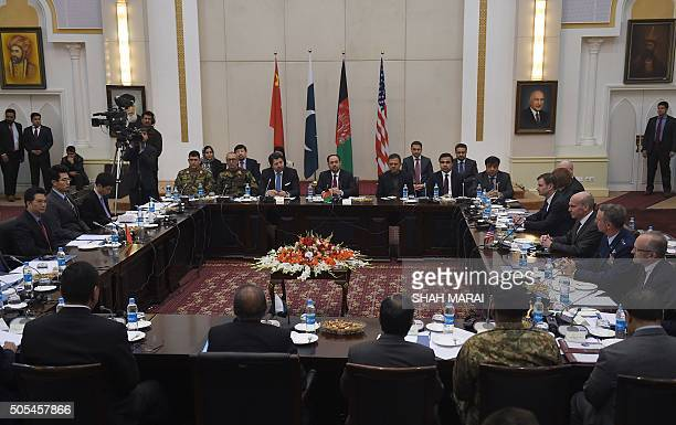 Afghan Foreign Minister Salahuddin Rabbanion chairs the second round of fourway peace talks at the Presidential palace in Kabul on January 18 2016 A...