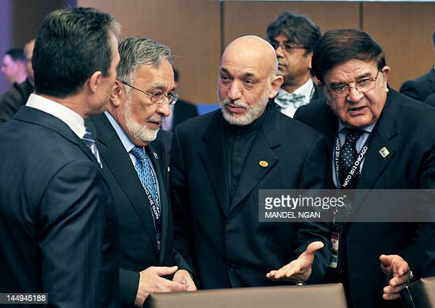 Afghan Foreign Minister Zalmai Rasoul Afghan President Hamid Karzai and Afghan Defense Minister Abdul Rahim Wardak chat with NATO Secretary General...