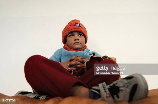 Afghan girl Hassina looks on as she sits in the premises of the Women for Afghan Women nongovernmental organisation in Kabul on December 18 2008...