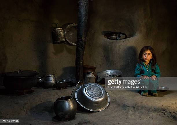 Afghan girl inside a traditional pamiri kitchen badakhshan province khandood Afghanistan on August 14 2016 in Khandood Afghanistan