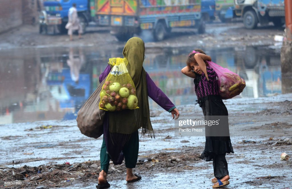 Afghan girls collecting usable fruits and vegetables form Badami Bagh market Pakistan is among 11 countries which represent almost 50 percent of the..