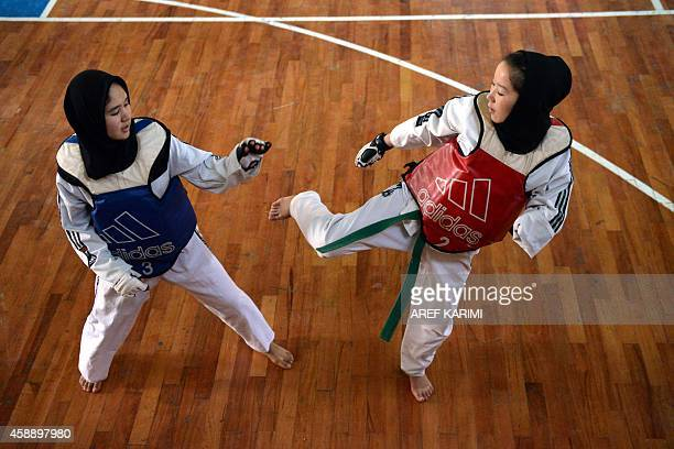 Afghan girls compete in a TaekwonDo match in Herat on November 13 2014 Women were banned from participating in sports by the thenruling Taliban...
