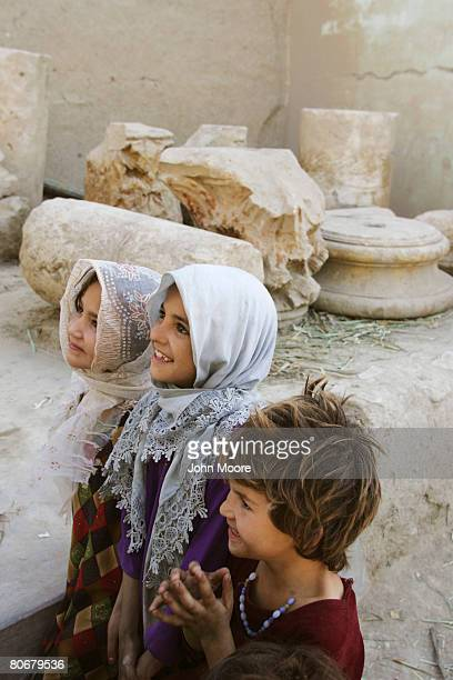 Afghan girls gather by a group of ancient Greek columns which were looted from an archaeological site on October 12 2006 at Balkh Afghanistan The...