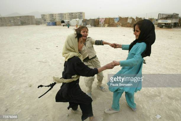 Afghan girls play together shoes October 12 2004 at the Babrak Garden Refugee camp in Kabul Afghanistan Over 150 Afghan families all labelled as...