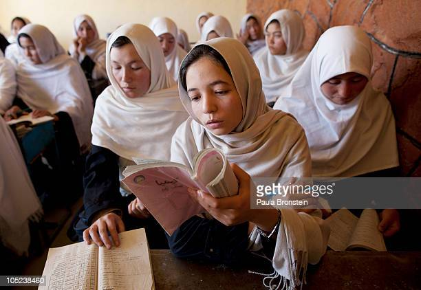 Afghan girls read during class at the Markaz high school October 13 2010 in Bamiyan Afghanistan In the peaceful province of Bamiyan girls are able to...