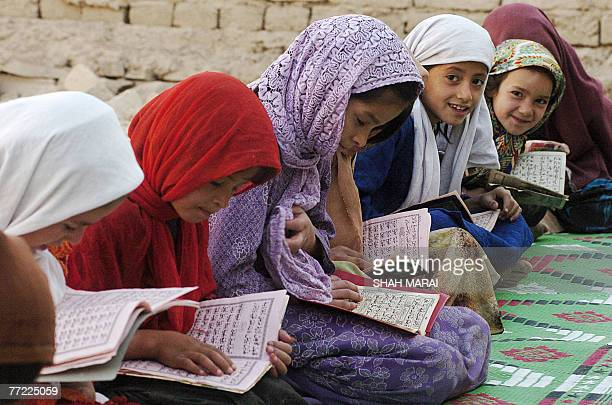 Afghan girls read the Quran at a mosque in Kabul 08 October 2007 during the holy month of Ramadan Muslims around the world are observing the holy...