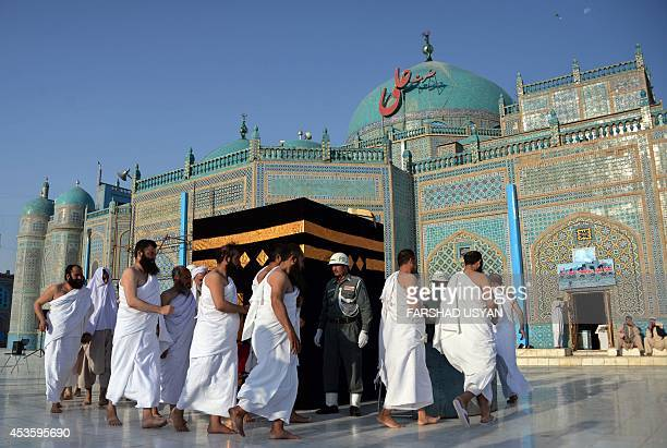 Afghan Hajj pilgrims undergo a training workshop with a replica of the Holy Kaaba Sharif erected in a courtyard of the HazrateAli shrine or Blue...