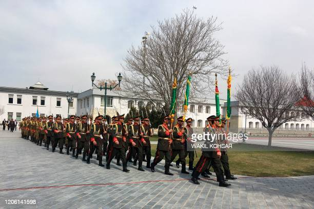 Afghan honour guards walk ahead of the oath inauguration ceremony of Afghanistan's President Ashraf Ghani at the Presidential Palace in Kabul on...
