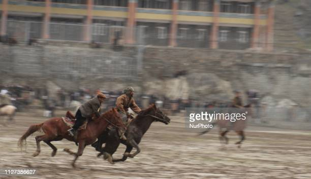 Afghan horsemen compete during a game of the traditional sport of buzkashi in Badakhshan Province Afghanistan on 25 February 2019 Buzkshai is an...