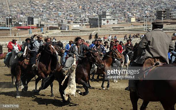 Afghan horsemen compete during the traditional sport of Buzkashi in Kabul on April 5 2012 The ancient game of Buzkashi is an Afghan national sport...