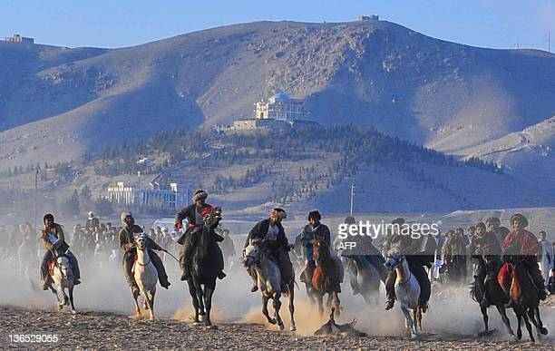 Afghan horsemen compete for the goat carcass during a game of Buzkashi in Herat on January 6 2012 The ancient game of Buzkashi is an Afghan national...