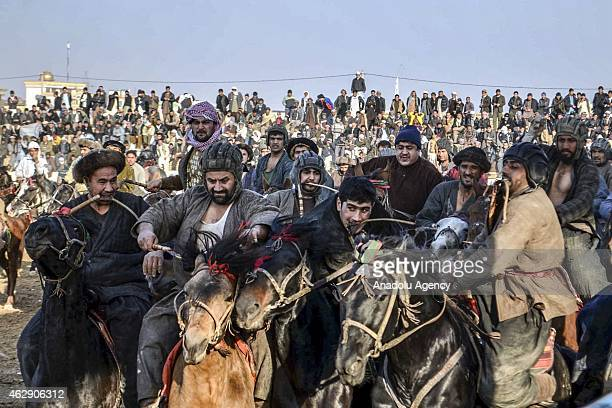 Afghan horsemen compete for the goat carcass during the traditional sport of Buzkashi at MazariSharif stadium in Balkh Afghanistan on January 30 2015...