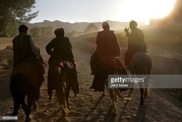 Afghan horsemen known as chapandaz ride at sunset while talking about their victorious buzkashi match September 2 2005 in Bamiyan Afghanistan The UN...