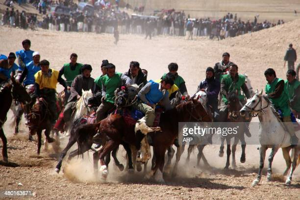 Afghan horsemen struggle to control a headless goat carcass during a game of Buzkashi near Bamiyan city in central Afghanistan on March 23 2014...
